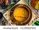 on a wooden tray  in a deep... | Shutterstock . vector #1115002502
