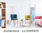 blue and green armchair in... | Shutterstock . vector #1115009855