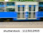 blue tram in motion. krakow ...   Shutterstock . vector #1115013905