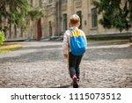 back to school. happy boy is... | Shutterstock . vector #1115073512