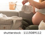pregnant woman packing... | Shutterstock . vector #1115089112