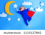 little baby superhero with red... | Shutterstock . vector #1115127842
