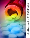 Small photo of Pile of pills coming out fro a pill bottle in color fantasy with psychedelic colors showing confusion or disorientation due to drug addiction