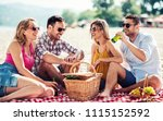 summer time. young couples on... | Shutterstock . vector #1115152592
