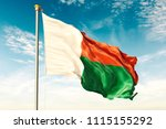 madagascar flag on the blue sky ... | Shutterstock . vector #1115155292