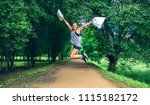 happy girl jumping with trash... | Shutterstock . vector #1115182172