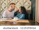 happy young couple is drinking... | Shutterstock . vector #1115193416