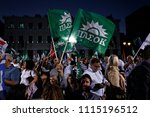 socialist party supporters wave ... | Shutterstock . vector #1115196512