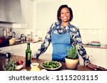 african woman in the kitchen | Shutterstock . vector #1115203115