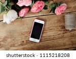 smartphone on the wooden table... | Shutterstock . vector #1115218208