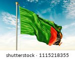zambia flag on the blue sky... | Shutterstock . vector #1115218355
