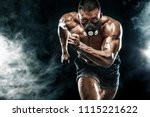 strong athletic man sprinter in ... | Shutterstock . vector #1115221622