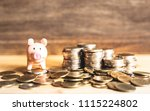 Small photo of A growth of coins for saving money concept with piggy bank,The expend for the future