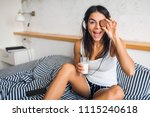 young smiling brunette woman... | Shutterstock . vector #1115240618