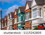 a row of colourful terraced... | Shutterstock . vector #1115242805