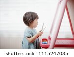 Baby Girl Drawing At Home