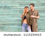 fashion couple standing posing... | Shutterstock . vector #1115254415
