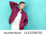 fashion guy in glasses poses... | Shutterstock . vector #1115258702