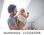 father with a toddler child... | Shutterstock . vector #1115263358