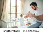 father with toddler children in ... | Shutterstock . vector #1115265062