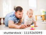 young father playing with a... | Shutterstock . vector #1115265095