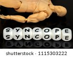 Small photo of a plastic model and a word syncope, a medical condition requiring emergency attention