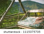 mountain porch swinging bench  | Shutterstock . vector #1115375735