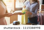 woman paying with credit card... | Shutterstock . vector #1115388998