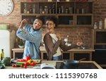 black couple dancing near table ... | Shutterstock . vector #1115390768
