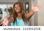african american woman at home... | Shutterstock . vector #1115412518