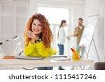 working mood. optimistic female ... | Shutterstock . vector #1115417246