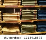 men's pants and jeans on store... | Shutterstock . vector #1115418578