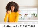 african american woman drinking ... | Shutterstock . vector #1115426378
