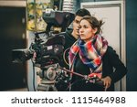 behind the scene. cameraman and ... | Shutterstock . vector #1115464988