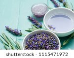 cup of lavender tea with a pile ... | Shutterstock . vector #1115471972