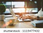 closeup hands of freelancer... | Shutterstock . vector #1115477432