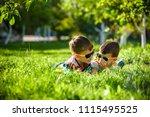 happy smiling boy sibling... | Shutterstock . vector #1115495525
