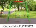 empty swings on the children's... | Shutterstock . vector #1115513972