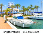 boats and beautiful lighthouse... | Shutterstock . vector #1115533325