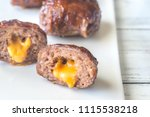 bacon meatballs stuffed with... | Shutterstock . vector #1115538218