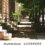 view of shady sidewalk  on a... | Shutterstock . vector #1115545355