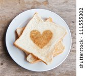 toasted bread with heart | Shutterstock . vector #111555302