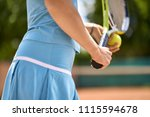 woman plays tennis on the court ... | Shutterstock . vector #1115594678