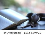 a stack of textbooks headphone   Shutterstock . vector #1115629922