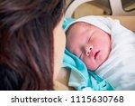 happy mother and newborn baby... | Shutterstock . vector #1115630768