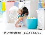 child in laundry room with...   Shutterstock . vector #1115653712