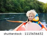 child with paddle on kayak.... | Shutterstock . vector #1115656652