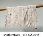 rag hanging on bamboo... | Shutterstock . vector #1115657045
