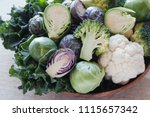 Small photo of cruciferous vegetables, cauliflower,broccoli, Brussels sprouts, kale in wooden bowl, reducing estrogen dominance, plant based vegan, ketogenic diet
