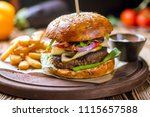 hamurger with fries | Shutterstock . vector #1115657588